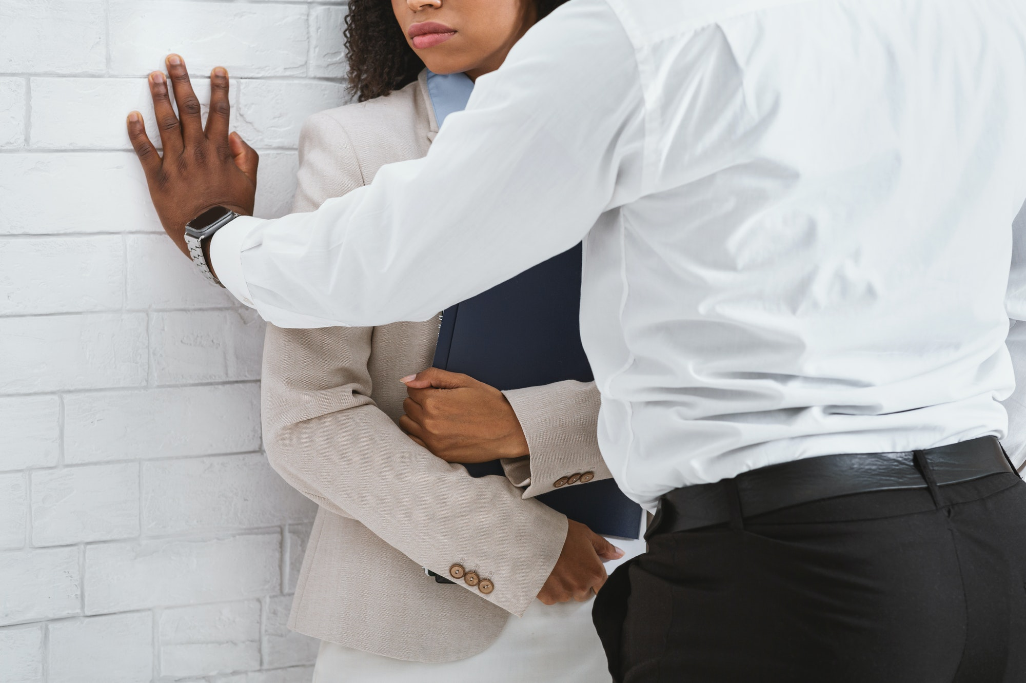 Workplace harassment. Closeup view of black guy making unwelcome sexual advances to his secretary in